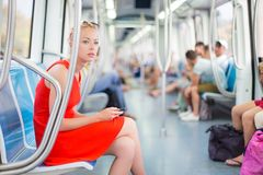 Lady traveling by metro. Royalty Free Stock Photo