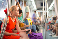 Lady traveling by metro. Stock Photography