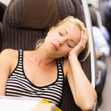 Lady traveling napping on a train. Stock Photography