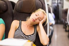 Lady traveling napping on a train. Royalty Free Stock Images