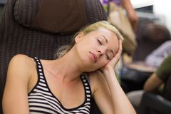 Lady traveling napping on a train. Stock Image