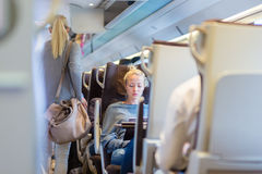 Lady traveling by train. Stock Photo