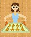 Lady with Tray of Gingerbread Men. Lady holding a tray of freshly baked cute gingerbread men Stock Photos