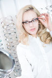 Lady trying new glasses Royalty Free Stock Images