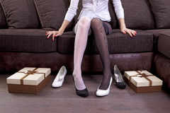 Lady trying on new shoes Royalty Free Stock Images