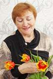 Lady with tulips Royalty Free Stock Photography