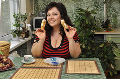 Lady with two eclairs Stock Image