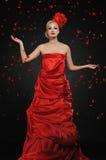 Lady under flower rain. Beautiful lady under flower rain Royalty Free Stock Photography