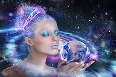Lady universe that holds the world. Earth provided by Nasa. Lady universe that holds and protects the world. Earth provided by Nasa royalty free stock images