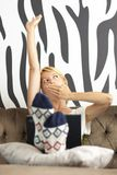 Lady using laptop, stretching and yawning Royalty Free Stock Images