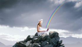Lady using laptop Stock Image