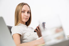 Lady using phone side Stock Photos