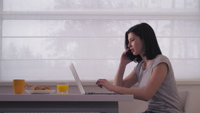 Lady using smartphone and pc in flat. stock footage