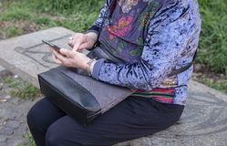 Lady is using a smartphone stock photography