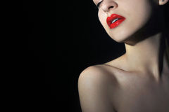 Lady vamp. Young woman portrait over black background Stock Photos
