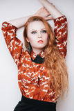Lady vamp. Sensual fashion portrait of redhead vamp girl with long hair Stock Photo