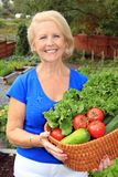 Lady vegetable gardener Royalty Free Stock Photo