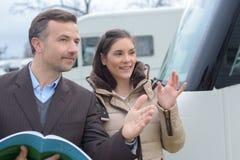 Lady with vehicle salesman. Vehicle stock photos