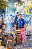 The lady vendor sell fried snack in downtown of Mandalay Stock Photo
