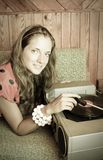 Lady with  vinyl plate and record player Royalty Free Stock Photos