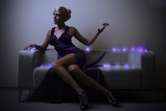 Lady in violet. Blond lady in violet dress Stock Photography
