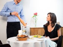 Lady and waiter in restaurant Royalty Free Stock Photography