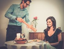 Lady and waiter in restaurant Stock Photo