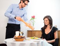Lady and waiter in restaurant Stock Photos