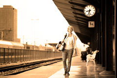 Lady waiting at the railway station. Royalty Free Stock Photo