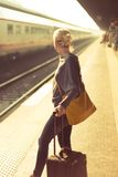 Lady waiting at the railway station. Stock Image