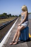 Lady waiting for train Royalty Free Stock Image