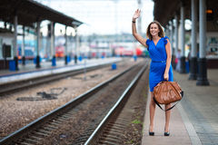 Lady waiting train on the railway station Stock Images