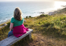 Lady Walker on Bench Gazing Out to Sea. Stock Image