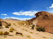 Lady walking in an arid landscape Stock Photo