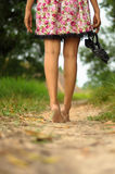 Lady walking away barefoot Royalty Free Stock Photography