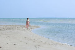 Lady Walking on the Beach. Rayong Province, Thailand Royalty Free Stock Photos