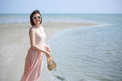 Lady Walking on the Beach Royalty Free Stock Photography
