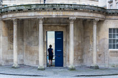 Lady walking through door of The Cross Bath Royalty Free Stock Photography
