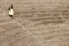 Lady walking down  steps at large theatre in Pompeii, Italy Royalty Free Stock Photo