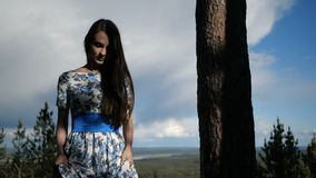 Lady is walking in the forest. Catching lady in long dress is walking in the forest stock video