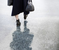 Lady walking in rain Stock Images