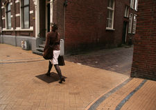 Lady walking in the street Royalty Free Stock Photography