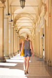 Lady walking streets of Bologna, Italy Stock Images