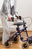 Lady walking with walker. Disabled lady during walking with walker, vertical stock image