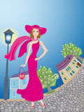 Lady  walks around an age-old town. Smiling glamour young lady in pink dress walks around an age-old town Stock Image