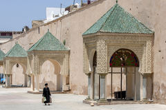 A lady walks through the beautiful Lahdim Square in Meknes in Morocco. Stock Images