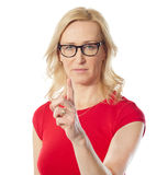 Lady warning you. Lady warning by pointing finger towards you Stock Photos