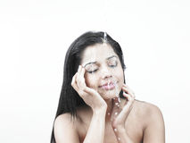 Lady with water in her face Stock Photo