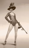 Lady and weapon. Lady, dressed in 1950's costume with a gun in her hands Stock Images