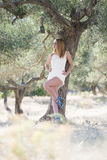 Lady wear white dress under the olive tree Stock Photos